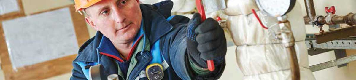 Worker with Solo Detector clipped to front of jacket